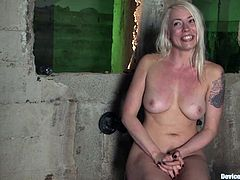 Slutty blonde Lorelei Lee is having fun with some guy in a basement. She lets the dude chain her and put wieghts on her hands and then gets her pussy rubbed with a dildo.