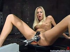 Cute blonde milf Angel Long is playing with a fucking machine in a basement. She rubs her juicy vag and then gets it drilled remarcably well by the machine.