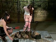 Sexy redhead girl gets tied up and showerd with a powerful jet of water. After that AnnaBelle kisses with Bobbi and gets tortured with electricity.