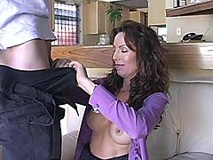 Gorgeous brown-haired milf is getting naughty with some dude in the kitchen. She favours the stud with a terrific blowjob and then they go to the bedroom and fuck doggy style and in the reverse cowgirl position.
