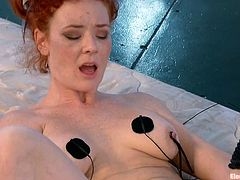 Horny redhead girl gets her tits tortured with electricity and ass fingered. After that Gia Demarco starts to to toy Audrey's ass with big metal dildo.