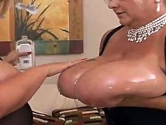 Lewd granny Linda is having fun with some huge-breasted blonde girl. The women show their enormous tits to each other and then oil them and rub the boobs against each other.