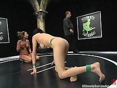 Naughty girls in bikini fight in a ring showing their nice asses and tits. After the fight the losing girl gets her sweaty pussy toyed deep and hard.