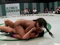 Groups of nude girls wrestle in a ring showing good martial arts skills. They also finger each others pussies in the heat of the battle.