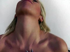 Peppering blond whore in tempting black and pink lingerie and fishnet stockings demonstrates her delicious body for cam before she sits with legs wide open to finger fuck her shaved pussy in solo sex video by Euro Babe Facials.