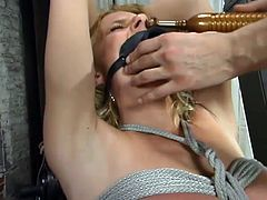 This gorgeous and sizzling siren Goldie is being tortured so fucking hard. She gets handcuffed on her legs and arms. Moreover babe has a yoke bar on her neck.