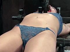 Naughty brunette girl lies on a torture table. She gets her tits and pussy clothespinned. After that she sucks a dildo and gets toyed at the same time.