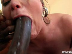 Nasty blonde milf Aurora Snow pleases a black stud with a hot deepthroat blowjob. Then she allows the dude to fuck her cunt and butt and can't help but moan with pleasure.