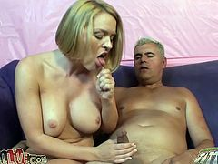 Big titted blonde slut Krissy Lynn with fake tits gets licked in pussy and fingered then at the end gets cum in mouth from Porno Dan in his studio.