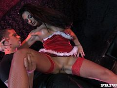 Sexy brunette Santa girl Aletta Ocean wearing fishnet stockings is having fun with some guy in a club. She shows her nice body to the guy and then lets him to fuck her coochie doggy style.