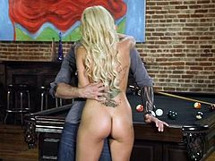 Slim blonde Breanne, wears her slutty short skirt. She looks fine and the guy can't help himself, not to hit on her. He tries his luck and doesn't even needs to work on that. The blonde is eager to fuck, so she gets naked, takes a place on the table and receives tongue and cock, in her tight pussy