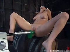 Hot bitch Ashley Gracie is having fun with a sex machine in some strange place. She rubs her juicy pussy and then gets it pounded hard by a fucking machine.