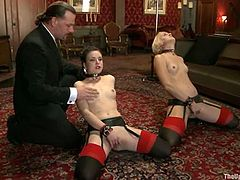 Two hot babes in stockings and garters get tied up. Later on they get their pussies fingered and fucked by the fucking machine. They also lick each others pussies.