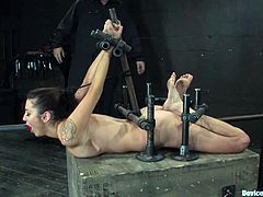 Sexy tattooed brunette Princess Donna Dolore is having fun with some guy in a basement. She lets him gyve her and then enjoys having dildos in her mouth and cunt.