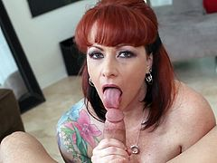 Hot redhead is eager to stroke this young cock and make it cum in her throat
