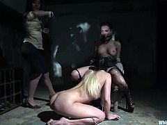 A blonde and a brunette get whipped painfully by their mistress in a basement. Then these submissive girls lick each others pussies and get toyed hard.