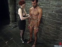 Kinky redhead mistress ties the guy up in her secret place. Then she humiliates the her sex slave with different bondage devices.