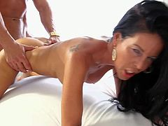 Skinny milf Tabitha Stevens with long legs and firm tits gets her tight trimmed pussy fucked deep and hard by horny as hell guy in Scarface XXX parody. Watch her enjoy sex on a snow white bed.