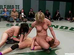 Nude chicks fight in the ring in public. They get so damn horny that start to lick each others sweaty pussies.