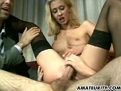 Lovely blonde babe gets her ass licked and pussy fingered at the same time. Then she sucks two dicks and gets fucked in both holes.