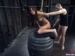 Slim brunette chick gets tied up by Chris Charming. She gets whipped and then face fucked. After that she also gets fucked and jizzed on her belly.