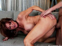 Lustful mommy Deauxma has got giant fake tits and fit body. She stands on her all four getting banged really hard doggy style. Awesome Naughty America porn vid that is indeed worth watching.