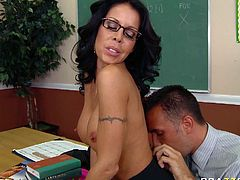 Seductive MILF punishes her student for misbehave. She hits his fingers with stick causing him pain. But right after she slapped his finger she sucked it sensually. Later on she lets him suckle her nipples and lick her pussy.