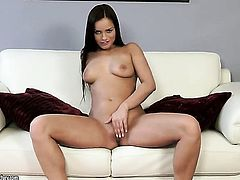 Brunette spreads her legs to fuck herself with sex toy