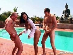 Sultry brunette woman Angel Dark is a proprietress of goddess like body shape with perfect B cup tits. She polishes to juicy cocks by the poolside outdoor starting passionate threesome fuck.