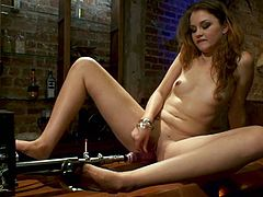 Adorable chick Allie Haze is having fun in a basement. She strokes her nice body and then gets her pussy pounded hard by a fucking machine.