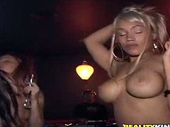 See how this guy has a great time with these horny blonde's after leaving the club with them. Watch them sharing his big cock in a threesome.