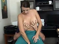 A curvy brunette milf is having a good time with some dude in an office. She favours the man with a blowjob and then leans against a desk and gets her coochie banged from behind.