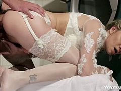 She looks cute and sexy at the same time in her white outfit,lying on bed on her side,she slowly gets her pussy penetrated by her friend's large cock.