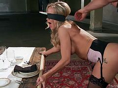 Simone Sonay grabs the edge of the table, as Mr. Pete uses a big vibrator on her from behind. Next, he makes her lay on the table and spread her legs, which he ties up with rope. Then she gets to use the vibrator on herself and experiences the amazing orgasm, like no other.