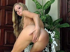 Young and adorable blonde hottie shows off while stroking deep in her shaved cunt