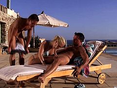 Engaging blonde Carla Cox is playing dirty games with two men outdoors. She sucks their pricks hungrily and then the studs double penetrate Carla while she is lying on a beach chair.