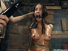 Petite brunette Jamie Huxley gets bound by her lesbian GF in a basement. Then she takes a ride on a fucking machine and undergoes some hot tortures.