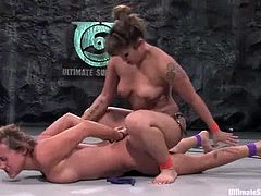 Asian and White chicks fight in a ring. DragonLily wins the battle and has a right to toy Gwen's vagina with big dildo.