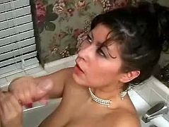 Big-breasted brunette Misty Mendez is having fun in a bathroom. She smashes her meaty vag with a dildo and pets herself. Then she kneels in front of her man and milks his dick dry.