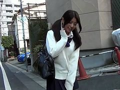Check out this hot innocent japanese schoolgirl in her sexy uniform walking around Tokyo. She lifts her skirt up to reveal her white panties and tight pussy.