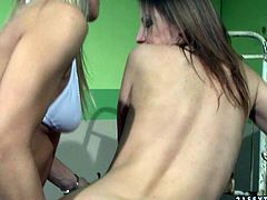 Sex appeal blonde nurse wearing sexy uniform explores ass hole of brunette patient with fingers. She spreads her palatable buttocks and stimulates her tight ass hole.
