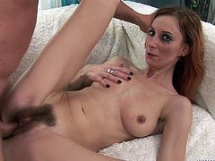 This redhead wears her high heels while a stud fucks her hairy pussy long and hard. He fucks her doggystyle, missionary, and cowgirl style.
