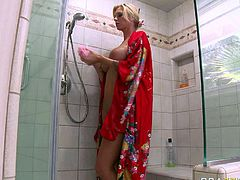 Busty blonde porn star Brooke Banner is wearing Japanese tradition costume looking hot and sexy. She gets her pussy pleased while she was washing floor sitting down on her knees. Later on she feeds the guy putting the sushi on her juicy boobs. At the end of the clip she soaps her body while taking shower in the bathroom.