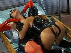 Horny babes in latex costumes are masturbating one another in bizzare masturbation show