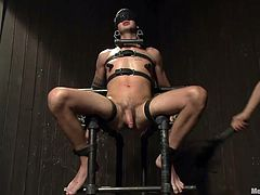 Jay is not sitting comfortable on those metal bars, but that's the whole point! He's tied and blindfolded, so he doesn't know, who's rubbing his cock and taunts him. He finds out, after the guys remove his blindfold and allow him to see what's happening. They twist his nipples and play with him some more