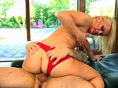 Pretty blonde Ash Hollywood with delicious ass in sexy red underwear and white shoes teases tattooed dude Tommy Pistol and gets banged to loud orgasms all over living room.