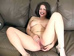 Amateur solo scene with a horny milf! She gets naked and spreads her legs wide to show you what she can do with her pussy, using a dildo!