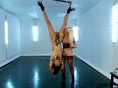 Sexy brunette girl gets hanged up upside down. Then she gets her hairy pussy tortured with claws. In addition she gets toyed with a dildo.