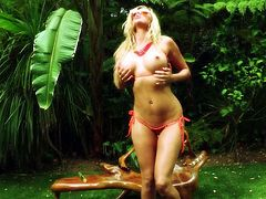 Deep in the jungle, blonde babe Samantha goes wild with herself. She's a wild beauty with a slim body, golden hair and a pussy, that demands satisfaction. Samantha rubs her breasts and that perfect ass and then, sits on the grass, spreads her thighs, and fucks herself. Keep on the good work baby!