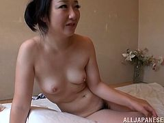 Chubby Japanese milf is having fun with some dude in the living room. She lets him play with her bushy snatch and then they have sex in cowgirl position.